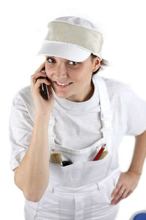 contacting: Female decorator contacting customer via telephone