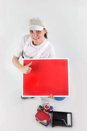 Painter pointing to a blank red sign photo