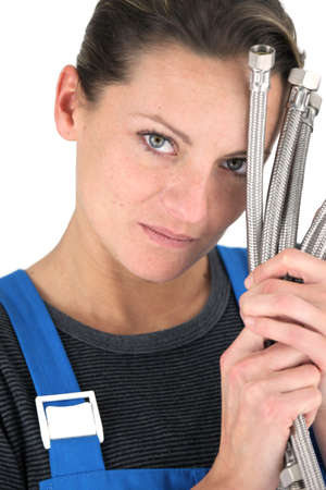 Female plumber with handful of pipes photo