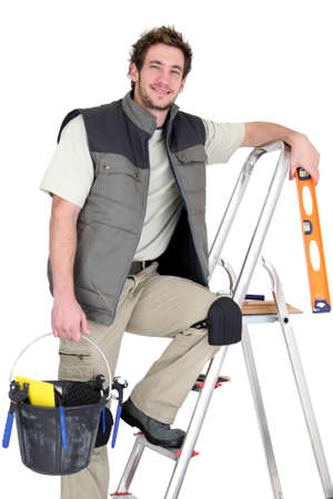 Tiler stood on ladder Stock Photo - 15071973