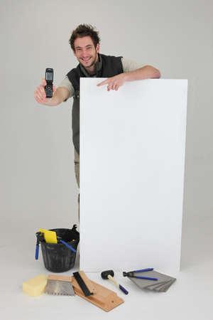 Decorator displaying mobile phone Stock Photo - 15072754