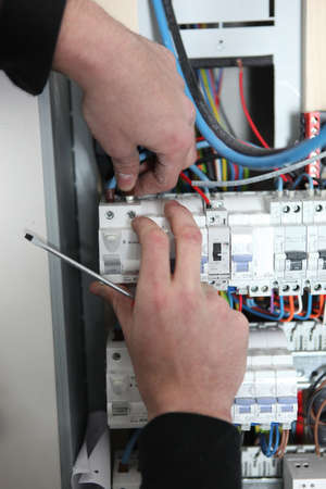 Man at a fuse box photo