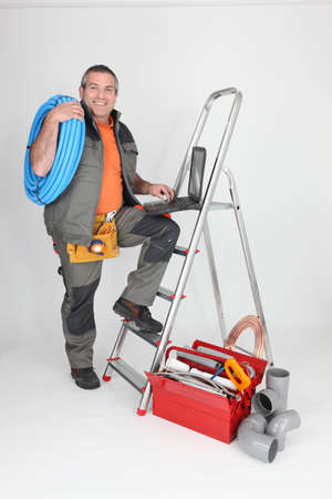Labourer climbing step-ladder photo