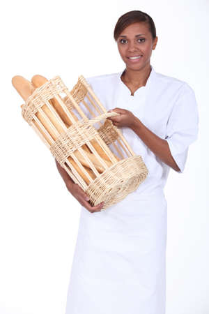 Brunette woman with a basket of bread photo