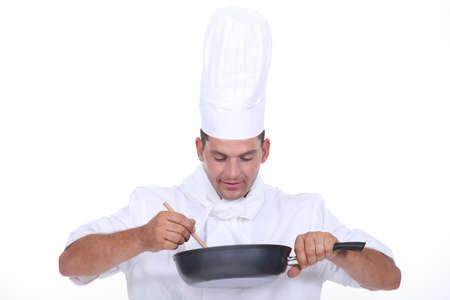 stirring: Chef stirring contents of saucepan
