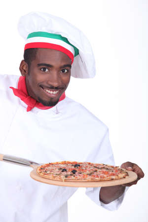 Chef with pizza on a wooden peel photo