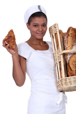 A baker with her bread and a croissant Stock Photo - 15072698