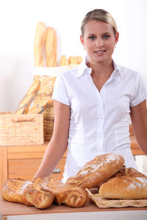 Young woman selling bread photo