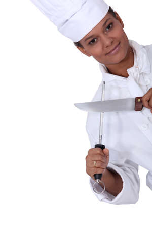 woman knife: a restaurant chef posing