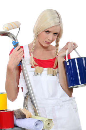 jumpsuite: serious female house painter Stock Photo