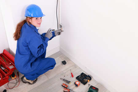 laboring: Female electrician