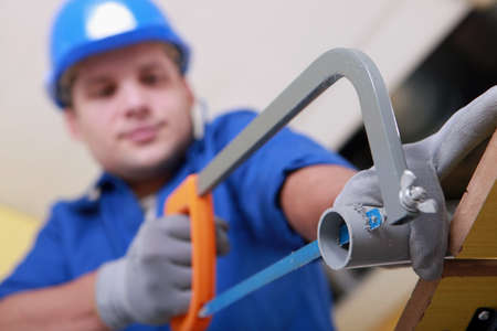 Plumbing sawing plastic pipe Stock Photo - 15072667
