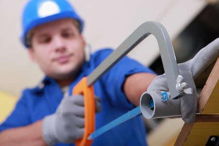 sawing: Plumbing sawing plastic pipe