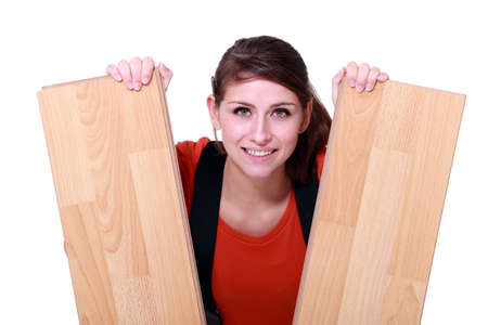 craftswoman holding two laminated boards photo