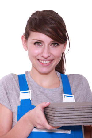 tile adhesive: Woman holding pile of tiles Stock Photo