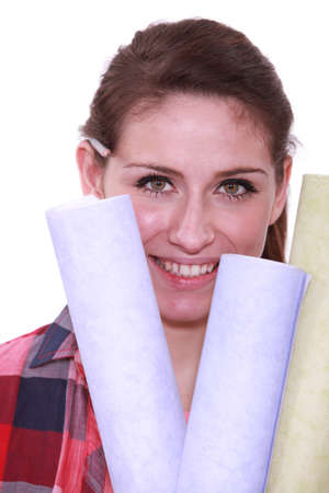ear checked: Woman holding selection of wallpaper