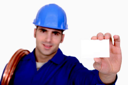 Plumber holding business card photo