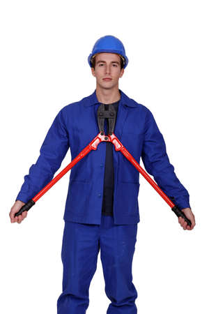 Man with a pair of long handled cutters Stock Photo - 15072417