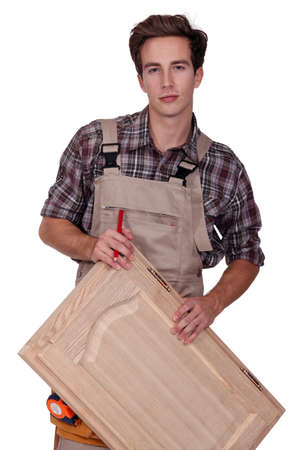 Carpenter holding cupboard door Stock Photo - 15072760