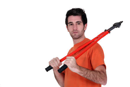 pry: Man stood with bolt-cutter Stock Photo