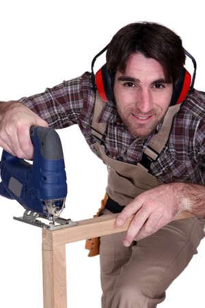 A carpenter using a tool Stock Photo - 15072663