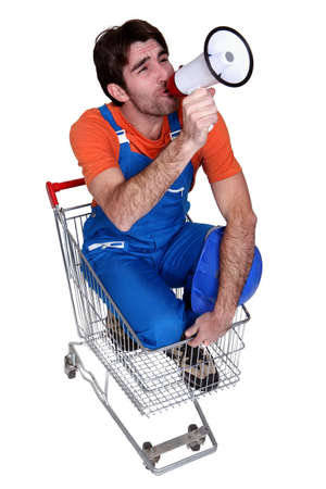 loudhailer: Man with a loudhailer in a trolley