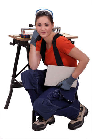 tile cutter: Female tile cutter Stock Photo