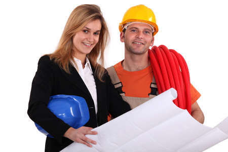 conferring: Tradesman conferring with an engineer Stock Photo