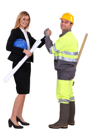 Engineer and a construction worker making a pact photo