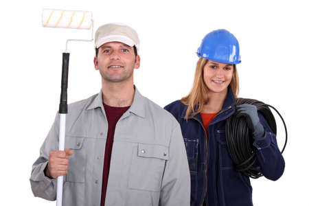 painter with roller and female electrician photo