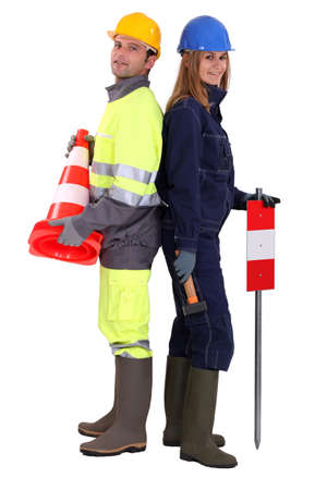 safety boots: Builders signaling with terminals