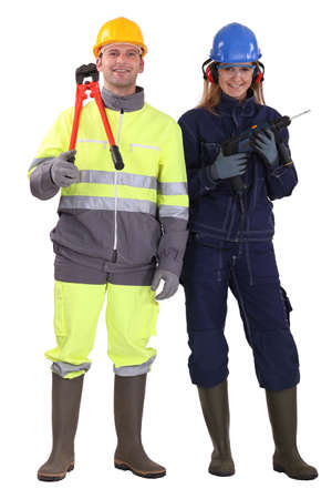 Man and woman with drill and pliers photo
