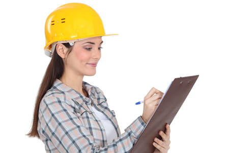 environmental conversation: Construction worker with a clipboard Stock Photo