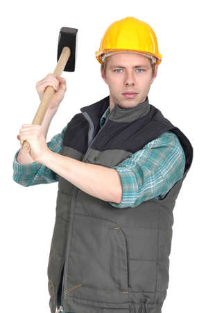 sledge hammer: Worker with a sledgehammer