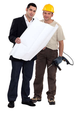 site manager: Businessman and builder discussing plans Stock Photo