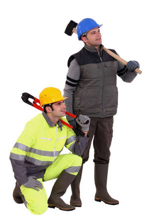 high visibility: A team of labourers staring off into the distance Stock Photo