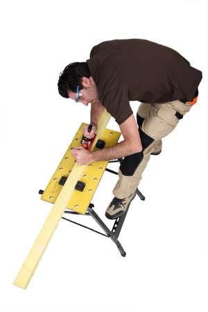 banter: Craftsman sanding wood Stock Photo