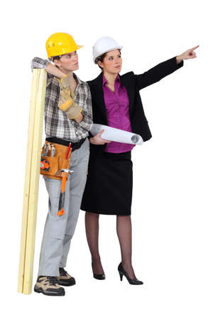 construction draftsman: a female carpenter and her manager Stock Photo