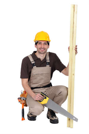 Carpenter with hand saw Stock Photo - 15095512