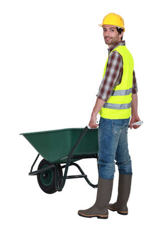 wheelbarrow: Man pushing wheelbarrow
