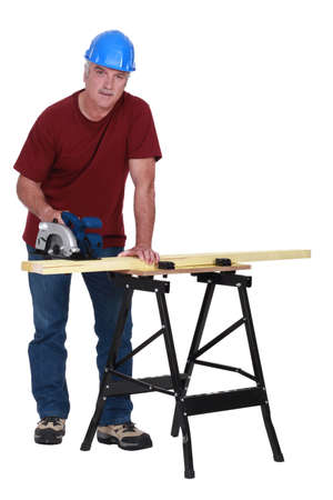 craftsman cutting a board photo