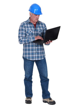 Builder with a laptop photo