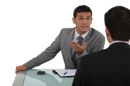 aggressive people: Two businessmen having heated debate Stock Photo