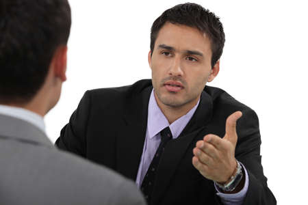 debate: businessmen having a discussion Stock Photo