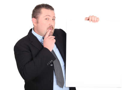robust: Perplexed man with white sign Stock Photo