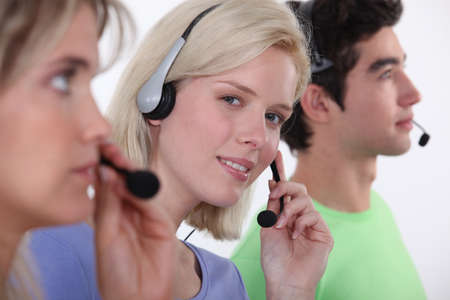 hot line: Three call-center workers Stock Photo