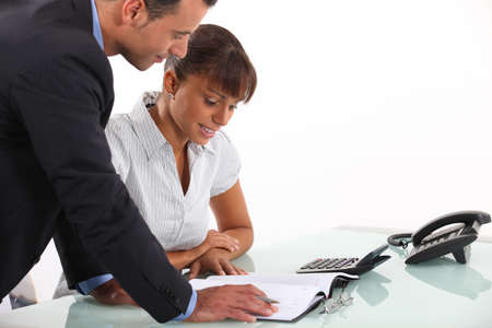business deal: Secretary showing boss his schedule