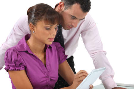 Two businesspeople reviewing notes photo