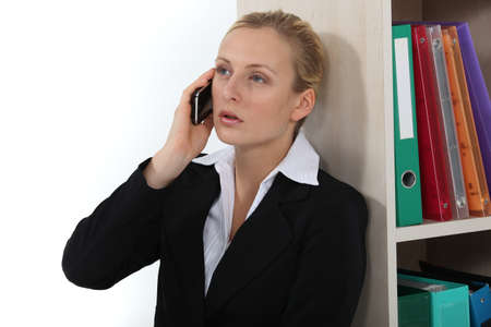 jaded: Business professional talking on her mobile phone Stock Photo
