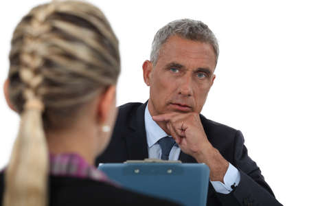 seeker: Businessman interviewing a young woman Stock Photo